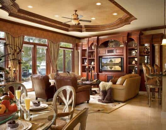 A traditionally-styled living room with tray ceiling effect in the center of the ceiling.