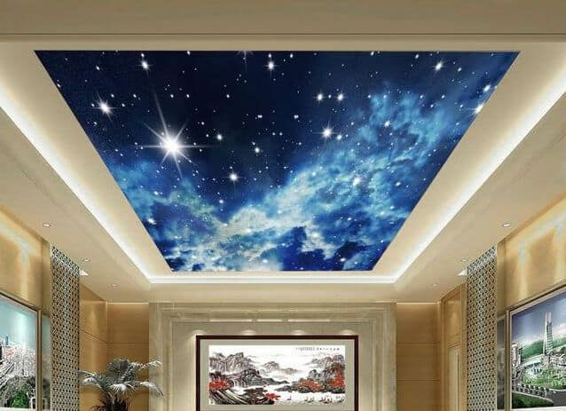 This room has a bright blue night sky complete with twinkling stars in the tray ceiling.