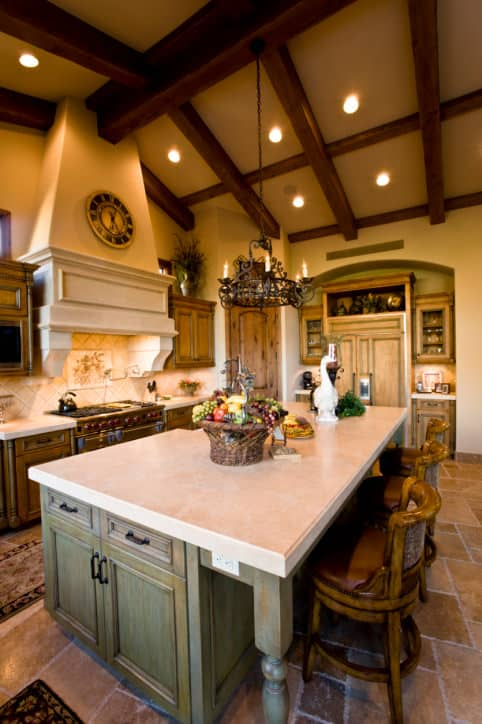 In a regular height room, this kitchen would be gorgeous. In the room with tall vaulted ceilings it's spectacular. I love that stove hood how it rises up really high drawing the eye up to the incredible cathedral ceiling.