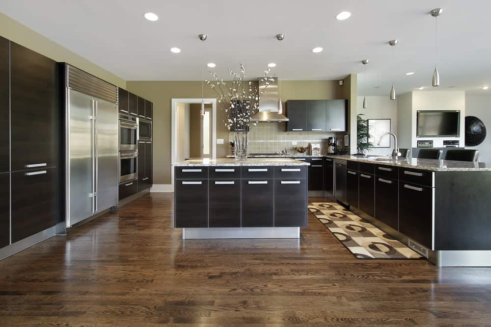 This is a masculine modern design with flat-panel dark cabinets and straight lines. It's actually a pretty simple design, but the silver hardware on the dark brown cabinets look great.