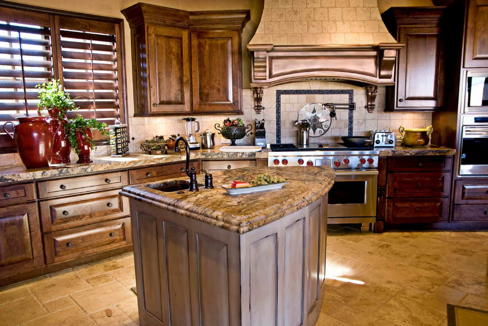 Single wall kitchen with raised panel cabinets, a central island and tile flooring.