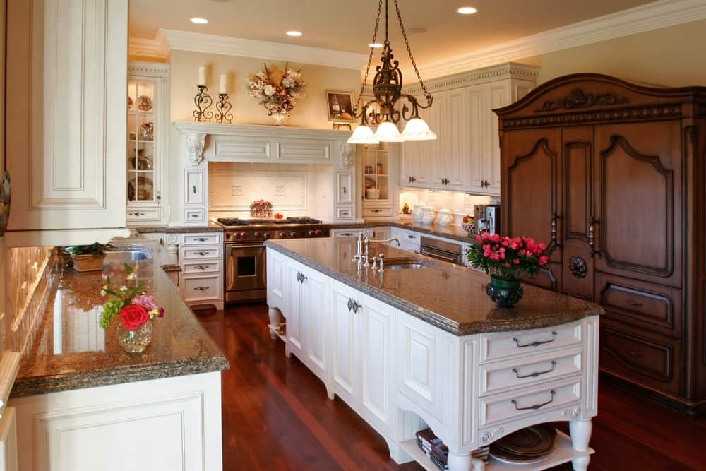 The ornament attention to detail really takes this design to the next level. This kitchen also offers classy counters with a large center island.