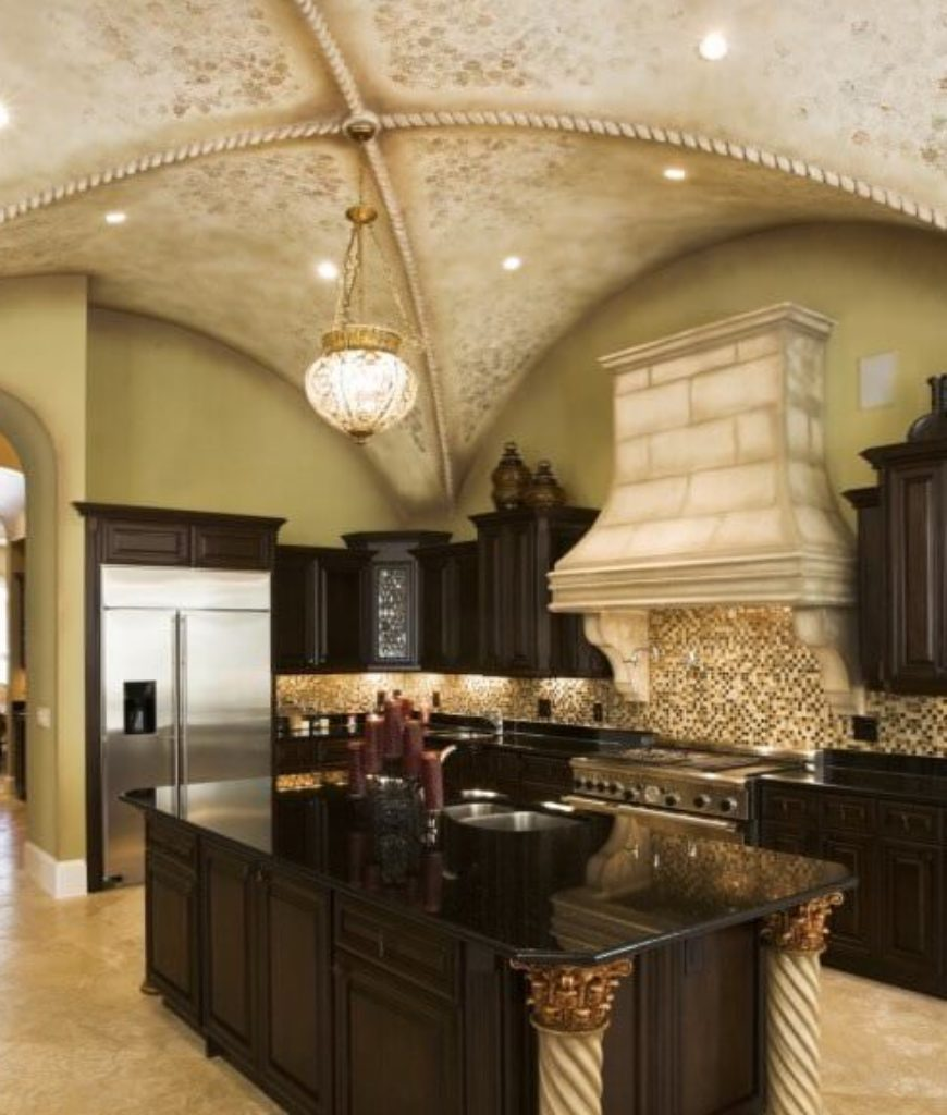 Contemporary kitchen with tall vaulted ceiling, arched doorway, green walls and dark brown cabinetry.