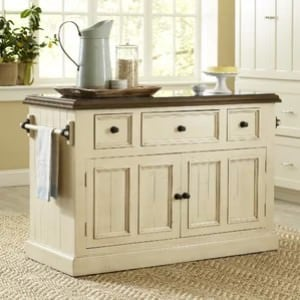 A stationary beige kitchen island.