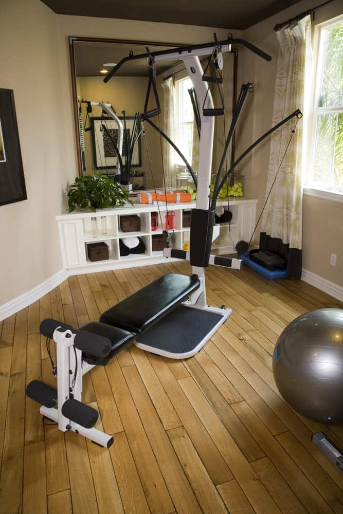Home gyms don't need a huge space to be effective. Even a small room with a cardio machine and weights can be enough to get fit.
