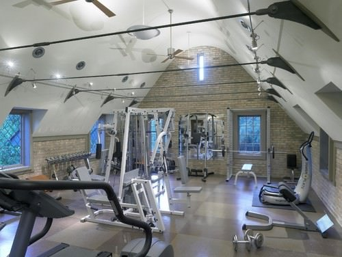 An industrial type of home gym with all the complete equipment for a serious fitness goal.