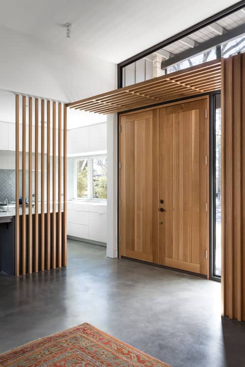 Midcentury Foyer With Wood Double Doors, Interior Wood Awning And Concrete  Flooring.Photo By Tim Cuppett Architects   Discover Entryway Design Ideas