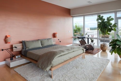 master bedroom design ideas pictures. large contemporary master bedroom with an orange accent wall, glass walls, built-in desks and indoor plants.photo by decorfin - browse ideas design pictures r