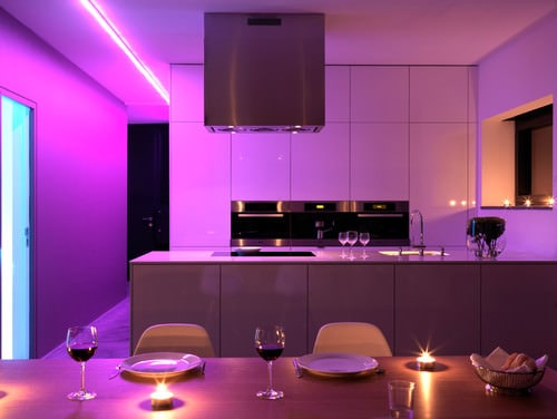 Contemporary pink dine-in-kitchen in U-shape with flat panel cabinets, peninsula and stainless steel appliances.