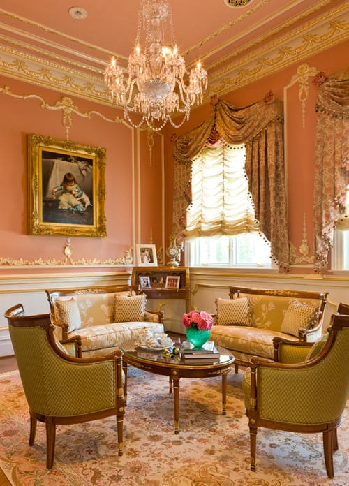 Large Victorian Formal Living Room With Gilded Crown Molding, Pink Walls,  Chandelier And French