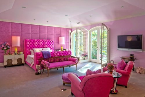 large pink master bedroom with tall ceiling two double glass doors and a seating areaphoto by rlb architecture search bedroom design ideas