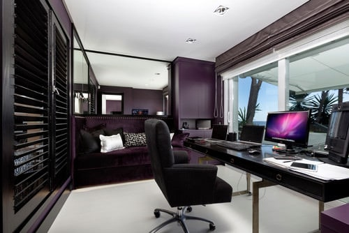 Mid Sized Modern Home Office With Purple And Glazed Walls, A Freestanding  Desk And