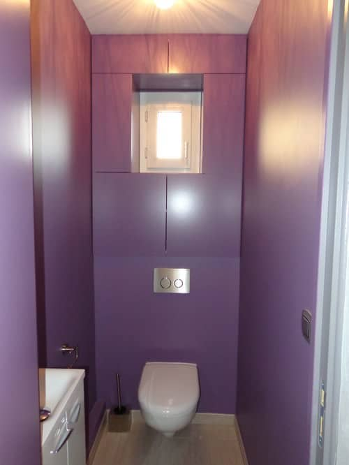 Purple modern powder room with sleek floor mount type toilet.