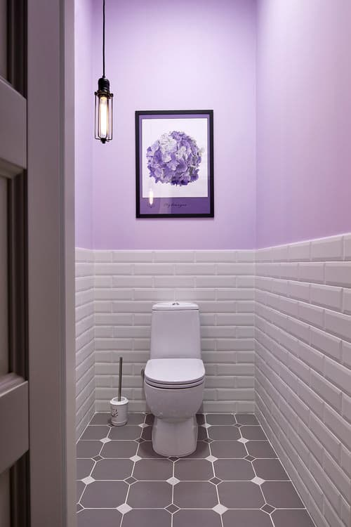 Purple Scandinavian powder room with two-piece toilet.