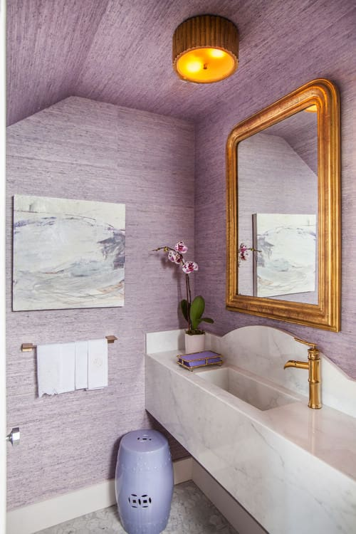 Purple Transitional powder room with mosaic tile floor and integrated sink.