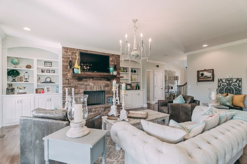 Large Shabby Chic Living Room With Built In Shelving, Brick Accent Wall, A  Wall Mounted TV And A Fireplace.Photo By Styling Spaces Home Staging U0026 Re  Design ...