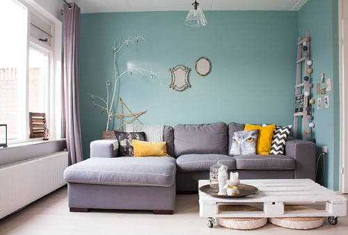 Shabby Chic Living Room With Green Walls, An L Shape Sectional Sofa And