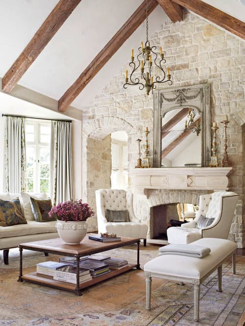 Shabby Chic Living Room With Cathedral Beam Ceiling, Arched Doorway, Stone  Brick Wall, Stone Fireplace And Carpet Flooring.Photo By Katie Scott Design  ...
