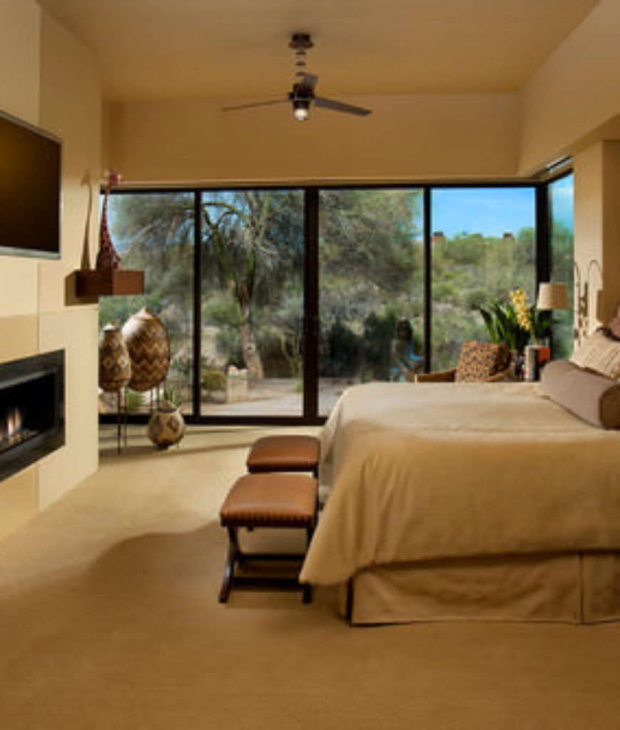 State-of-the-art Southwestern master bedroom with remote-controlled gas fireplace, TV, lighting, audio and window coverings.