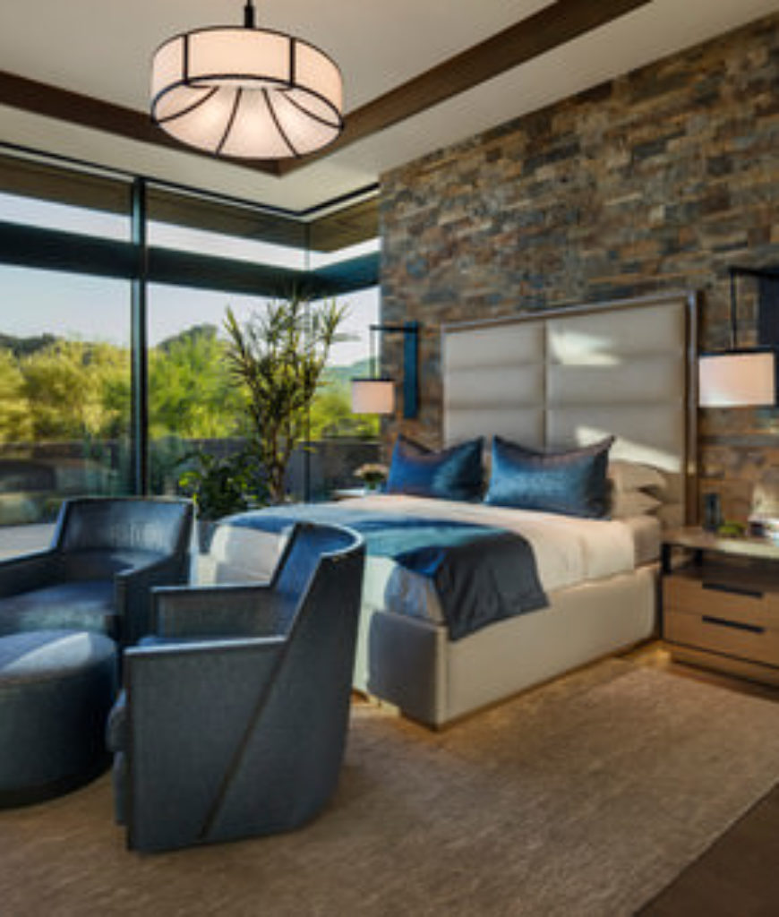 Large Southwestern master bedroom with tray ceiling and panorama windows with views to the desert outdoor.
