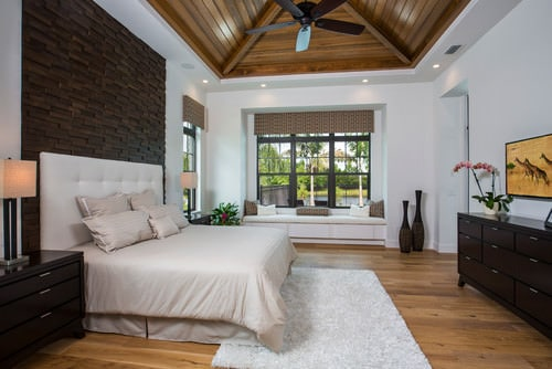 Large Tropical master bedroom with beam ceiling  white walls  built in  window seat and brick accent wall Photo by   Search bedroom pictures. 165 White Master Bedroom Ideas for 2017