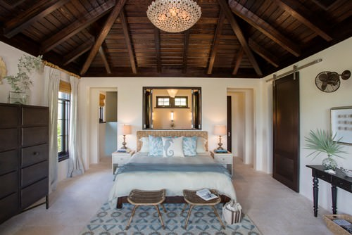 20 tropical master bedroom ideas for 2019large tropical master bedroom with beam ceiling, carpet flooring and doorways on the sides of