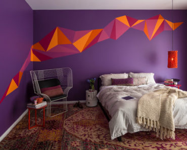 Contemporary master bedroom with an artistic purple wall.