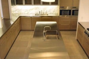 Stainless steel kitchen island with sink.