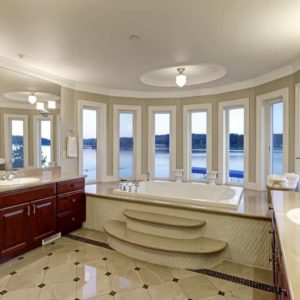 Large primary bathroom with bay window.