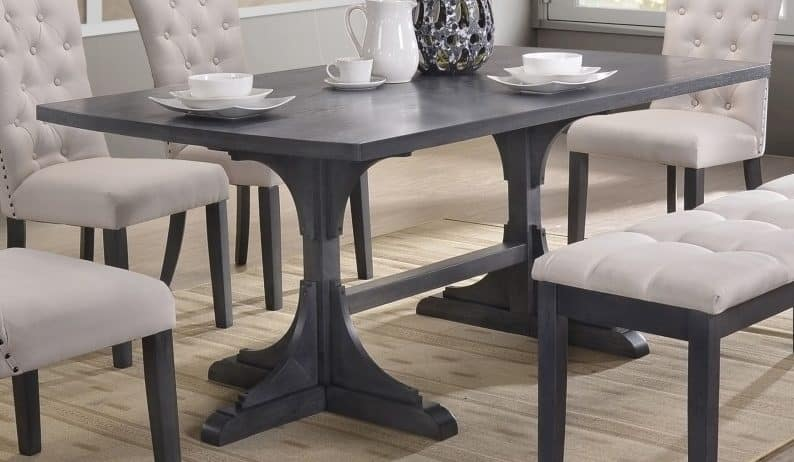 Light grey wood traditional rectangular dining table.
