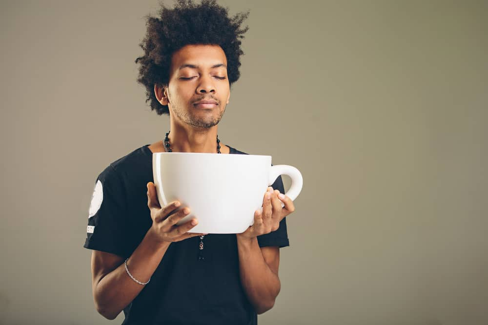 Man holding huge cup of coffee