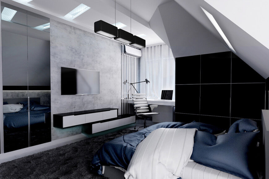 This master bedroom boasts a comfy bed facing the TV mounted above the floating shelves. It includes modern black pendants and a sleek white desk paired with a stylish swivel chair.