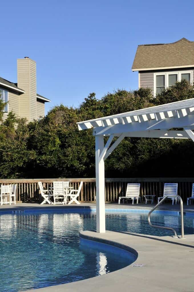 This pergola extends from the concrete deck and over part of the pool. You can enjoy the shade of the pergola from inside the pool on from a chair on the deck.
