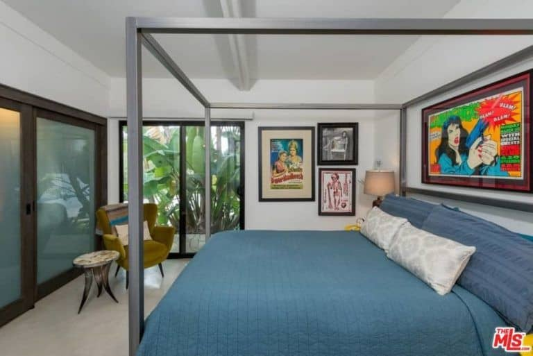 One of the two guest bedrooms in Ellen Pompeo's house featuring vintage wall arts.