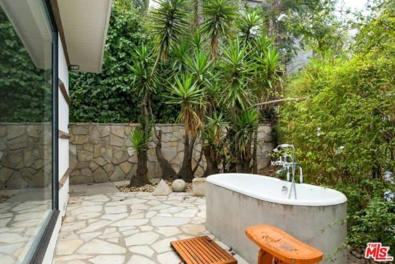 The master bathroom in Ellen Pompeo's house boasts an outdoor bathtub to rinse off after a soak in the swimming pool.