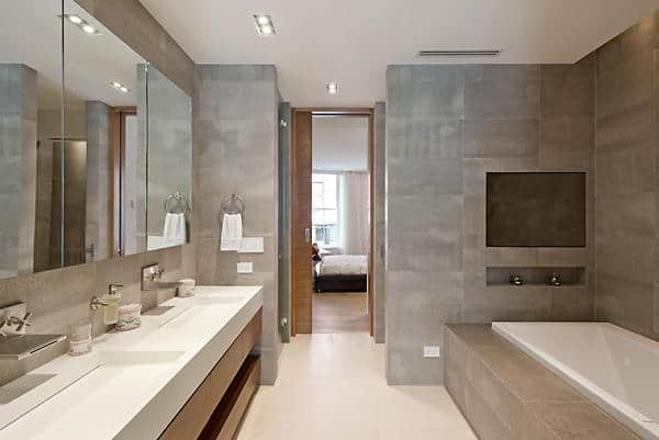 The bathroom of Taylor Swift's property features a deck mounted bathtub , gray walls and recessed lights.