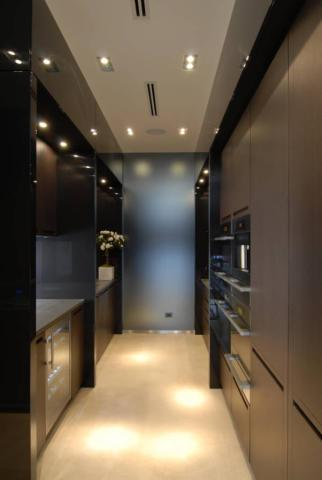 The several recessed lights make the kitchen of Taylor Swift's pad look top notch, highlighting the dark accents of the huge built-in shelving in the space.