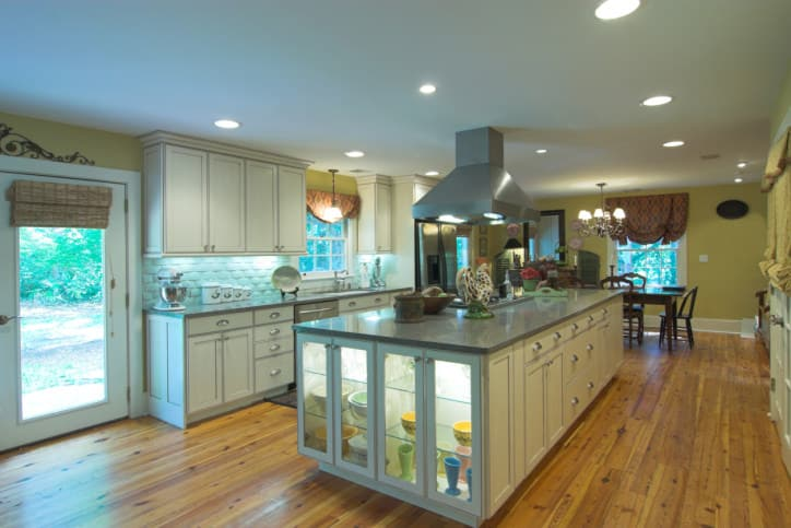 I simply love that island with how the side glass-faced cabinets are lit. It creates a really great lighting effect that outshines much of the rest of the kitchen.