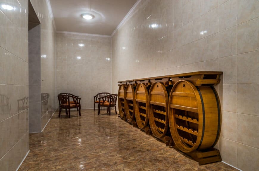 Austere room with custom barrel-style storage cabinets and small tasting area at the end of the room.