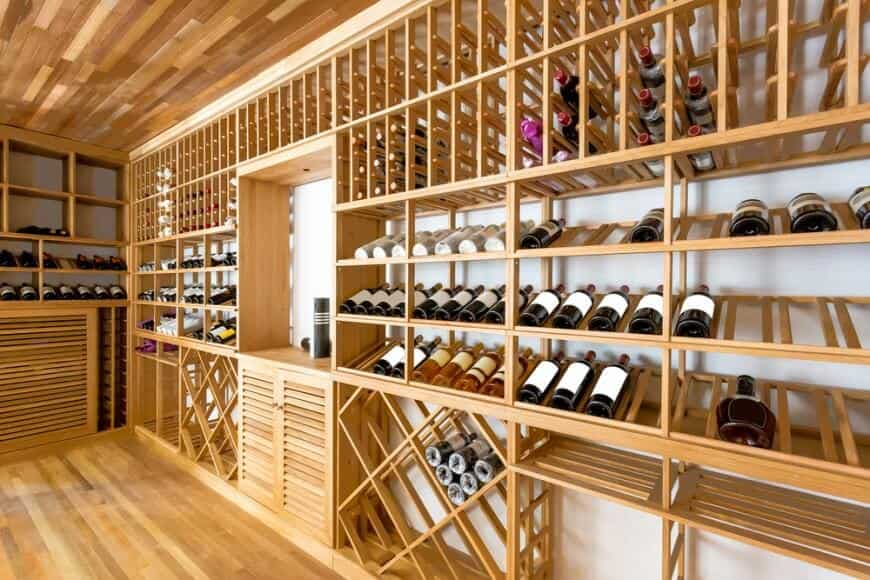 while this is a commercial setting the display cases are an interesting design concept to add to any private home cellar and tasting room - Wine Cellar Design Ideas