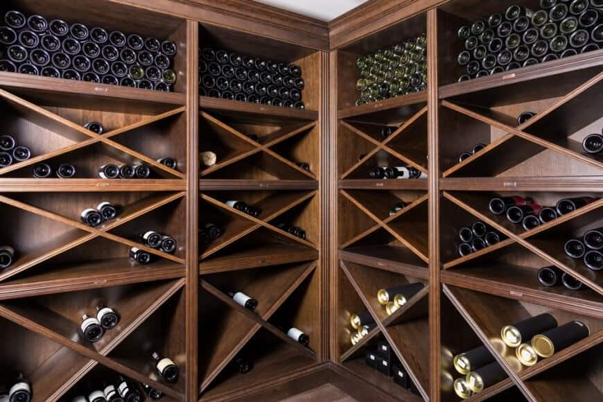 Close-up of custom wood cabinets designed for storing maximum number of bottles.
