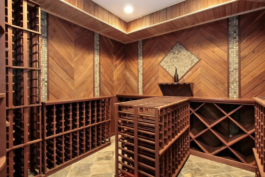 wood design with waist high wooden cabinets and wood paneling walls with tile inlay a storage island is in the center of the room - Wine Cellar Design Ideas