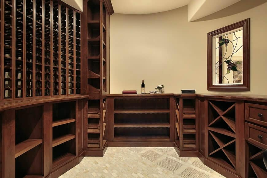 Example of a small space turned into an elegant cellar with dark wood storing cabinets over a tiled flooring.