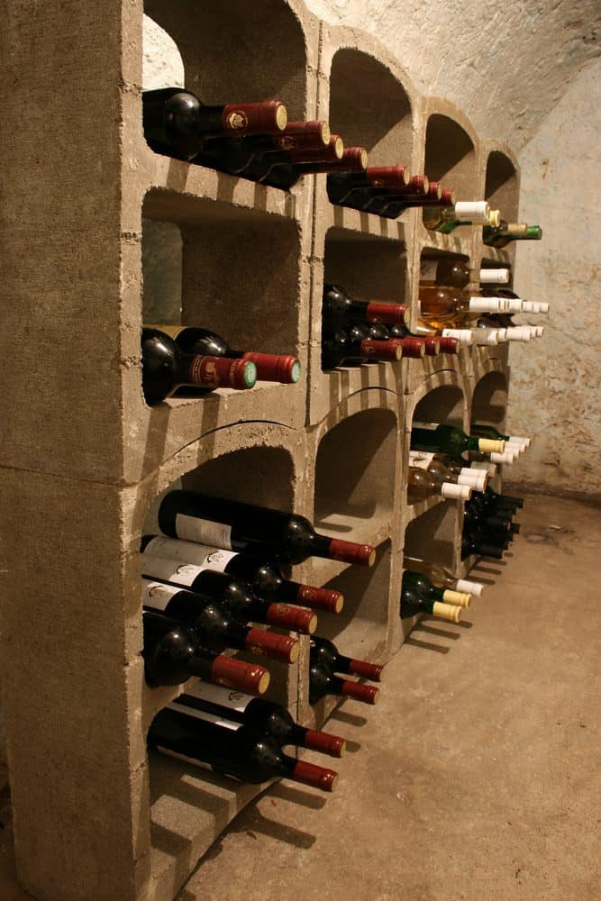 A stone wall with a vaulted ceiling and a built-in wine compartment that guarantees a fresh bottle each time.
