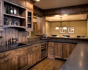 Kitchen with wood backsplash.