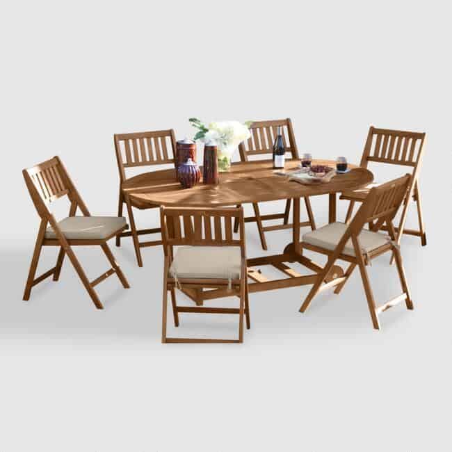 World Market's oval wood Lira 7 piece folding dining set.