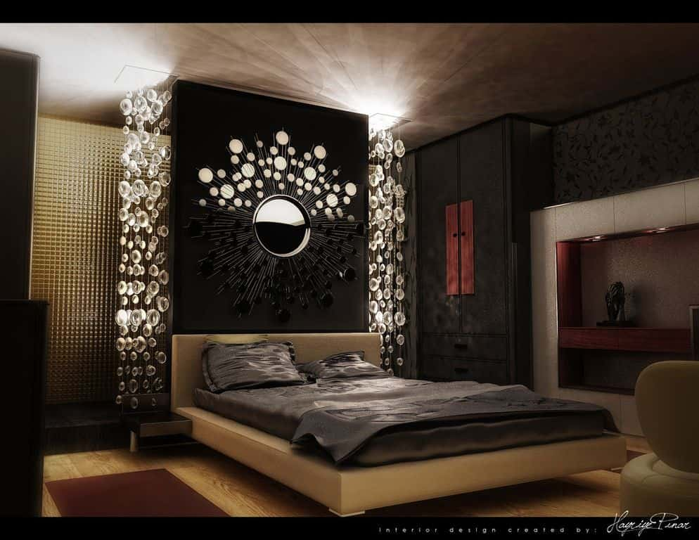 Contemporary master bedroom featuring a sunburst mirror on the accent wall flanked by cascading crystal lights.