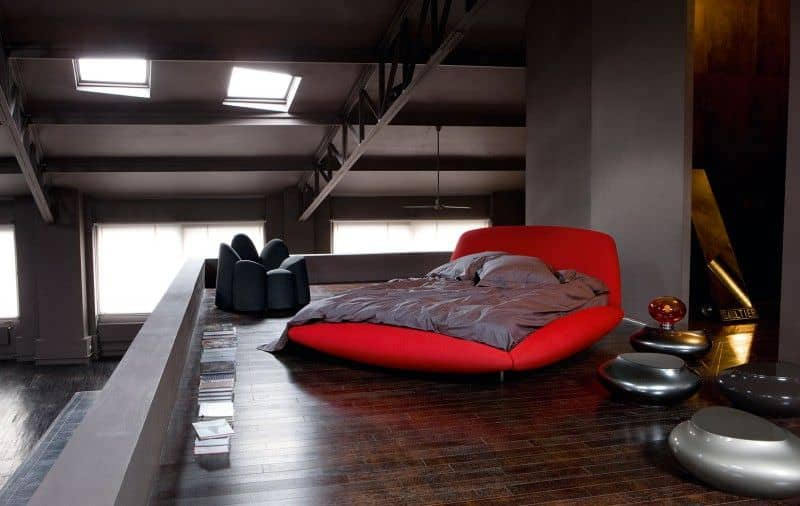 Interesting primary bedroom set with a hardwood flooring and beams ceiling.