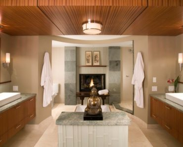 Asian master bathroom with flushmount lighting, wall sconces, walk-in shower and vessel sinks on floating vanities.