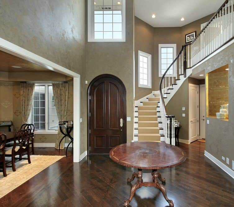 Transitional foyer with table centerpiece and hardwood floors.